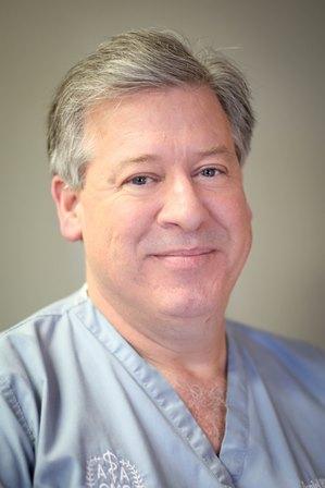 Daniel E. Riggs, D.D.S., M.D.