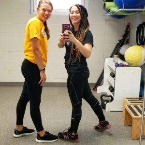 Two girls in gym selfie